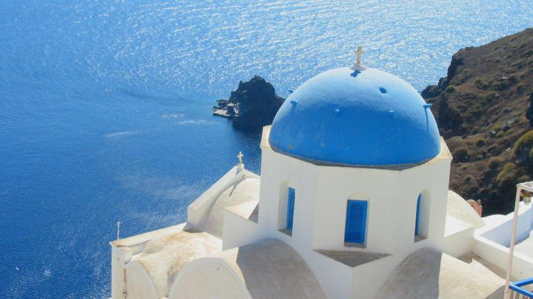 Santorini - island with the breattaking view of the Aegean sea.